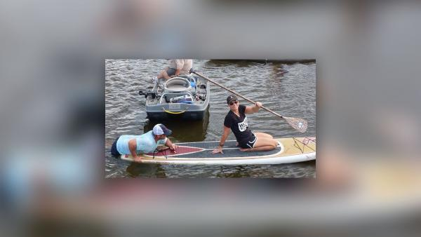 Fisher board rescues boater